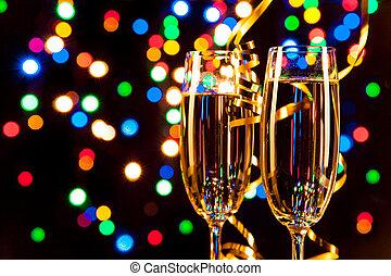 Celebration theme - Glasses of wine with blur light spots on...