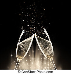 Celebration theme - Two glasses of champagne with splash, on...