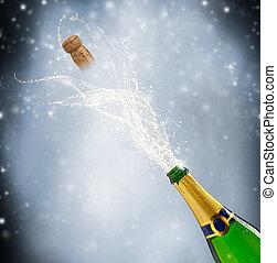 Celebration theme with splashing champagne on black