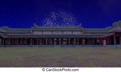 Celebratory fireworks for new year over Gate of the Forbidden imperial City at Hue, Vietnam during last night of year. Christmas atmosphere