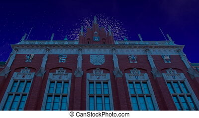 Celebratory fireworks for new year over the Collegium Novum in Cracow   Krakow, Poland during last night of year. Christmas atmosphere