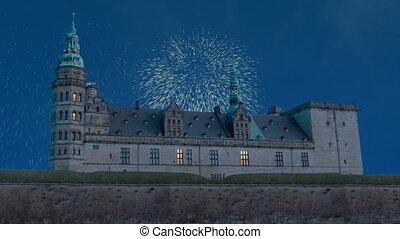 Celebratory fireworks for new year over Kronborg castle the Helsingor (Elsinore) town, Denmark during last night of year. Christmas atmosphere