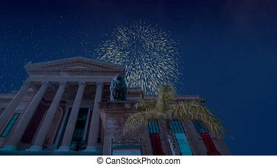 Celebratory fireworks for new year over massimo theatre palermo in italy during last night of year. Christmas atmosphere