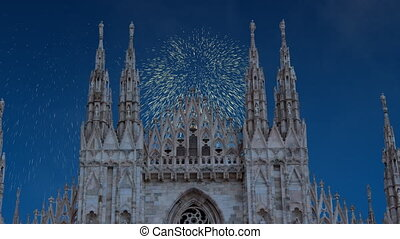 Celebratory fireworks for new year over Milan cathedral or duomo di milano during last night of year. Christmas atmosphere
