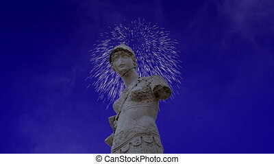 Celebratory fireworks for new year over minerva statue of Brescia, Italy during last night of year. Christmas atmosphere