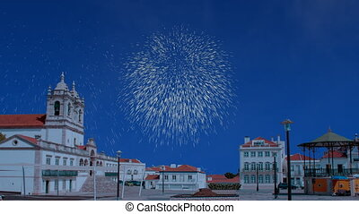 Celebratory fireworks for new year over Nazar? in Portugal cathedral during last night of year. Christmas atmosphere