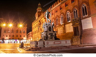 Celebratory fireworks for new year over Neptune statue in Bologna during last night of year. Christmas atmosphere