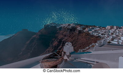 Celebratory fireworks for new year over Oia town cityscape at Santorini island in Greece. Aegean sea during last night of year. Christmas atmosphere