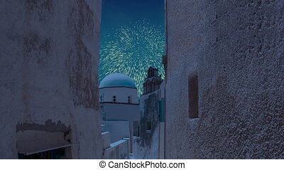 Celebratory fireworks for new year over orthodox white church blue dome in santorini, Greece during last night of year. Christmas atmosphere