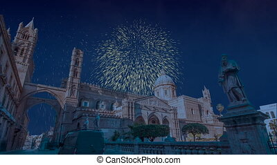 Celebratory fireworks for new year over Palermo Cathedral in Palermo, Italy during last night of year. Christmas blue atmosphere
