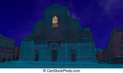 Celebratory fireworks for new year over Saint Petronio basilica or church or cathedral in Bologna, Italy during night