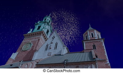 Celebratory fireworks for new year over Wawel Castle in Krakow or cracow - Poland, during last night of year. Christmas atmosphere