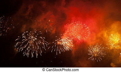 Volleys of celebratory fireworks in the night sky