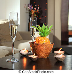 Romantic still-life with wine glasses for champagne and candles