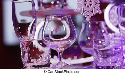 Elegantly decorated Christmas table. In the background, TV works
