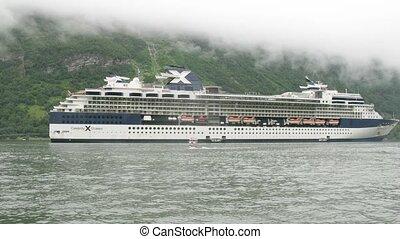 Celebrity Cruises liner at bay - GEIRANGER, NORWAY- JUNE 28:...