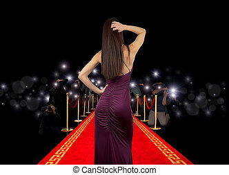 Celebrity on red carpet with photographer