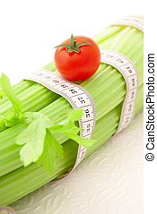 Celery and tomato with tape measure