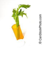 Alternative Medicine Concept - Celery in a medicine bottle -...