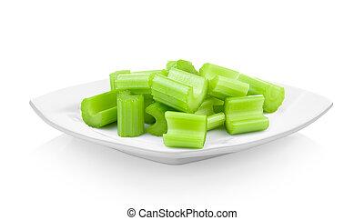 celery in ceramic white plate on white background