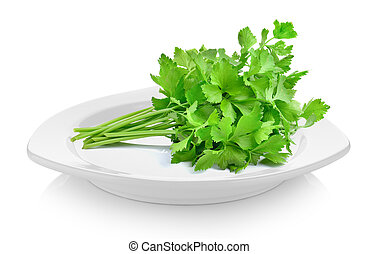 celery in white plate on white background