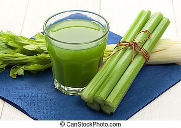 Celery juice - Green vegetable juice with celery stalk on ...