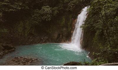 Celeste river waterfall and pond, Tenorio Volcano, Costa...
