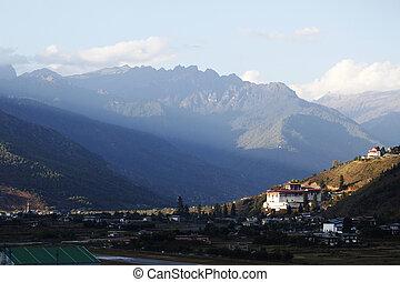 Ray of light falling upon Paro Dzong, Bhutan.