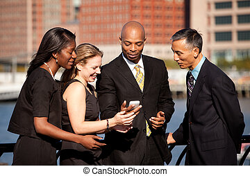 Cell Phone Business - A group of business people crowded...
