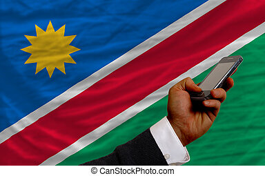cell phone in front  national flag of namibia