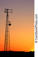 Cell Phone Tower Sil - A cell phone tower silhouette in the...