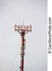 Cell site, Telecommunications radio tower or mobile phone base station with atop the antennas isolated with white sky background.