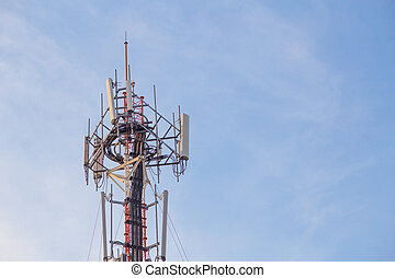 Cell site, Telecommunications radio tower or mobile phone base station with atop the antennas with Blue Sky and cloud background.