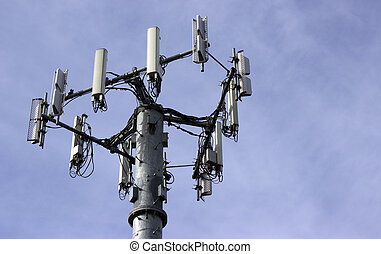 Close shot of a cell tower on a blue sky background.