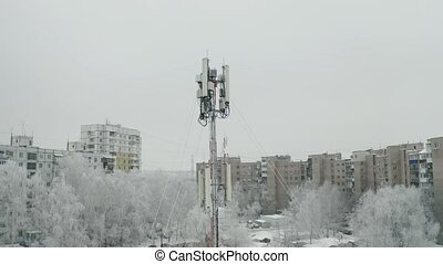 Cell tower in city - Frozen snow covered cell tower in city...
