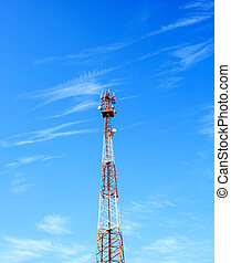 Red and white communication tower with beautiful clear sky