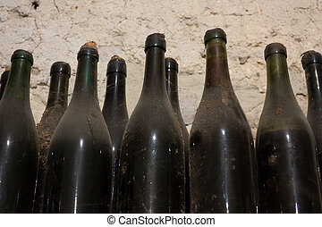 old bottles - cellar with dusty old bottles of wine