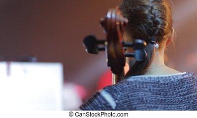 Cello. Musicant play on cello