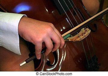 cello player  - Close up of a cello player