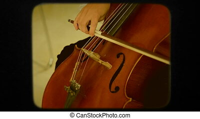 Cello Technique In action. Retro - Close-up detail on the...