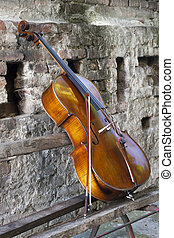cello - Vintage violin on the bench