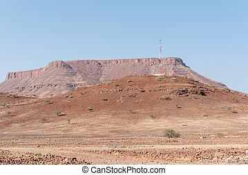 Cellphone tower on hill in the semi-desert landscape, Bergsig