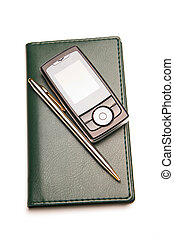 Cellular phone and pen on organizer