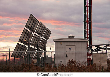 Cellular site and solar panels - sunset time