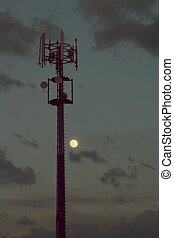 Cellular tower and Sunset. Equipment for relaying cellular...