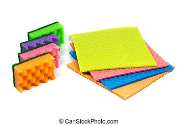 Cellulose sponge cloth and an organized stack of cleaning sponges, isolated on the white background