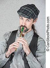 Celtic Folk Musician Playing Flute - Handsome Irish folk...