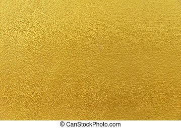 Cement background with a texture of gold wall