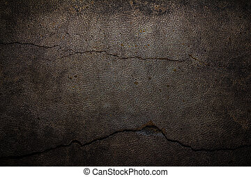 Cement background with cracked leather