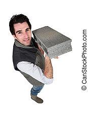 Cement block craftsman in the hands